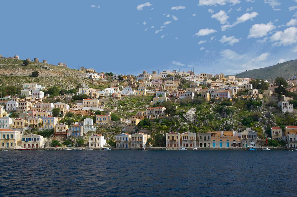 Free Colorful houses lining the harbor at Symi, Greece