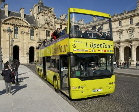 Free A tourist bus in front of the Louvre, Paris