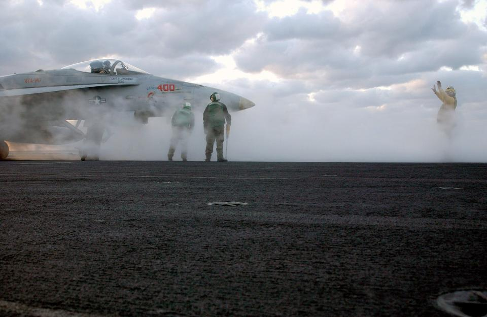 Free The Flight Deck Director guides an F/A-18C Hornet