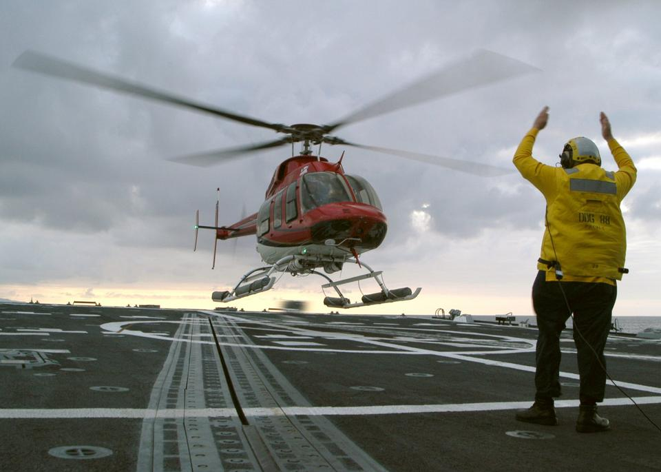Free Class Tito Alvarez directs a commercial Bell 4 helicopter