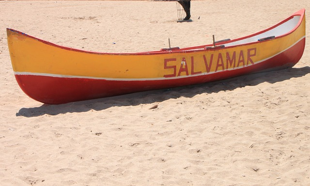 Free abandoned lifeguard boat beach lonely sandy beach