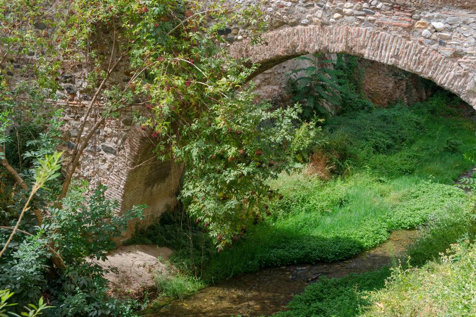 Free Old stone bridge across small stream in the woods