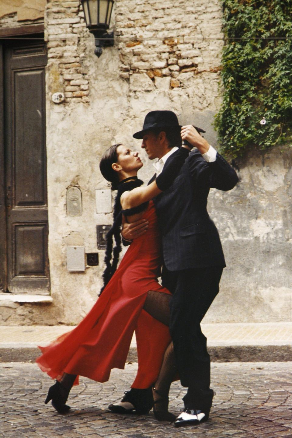 Free A man and a woman dancing argentinian tango