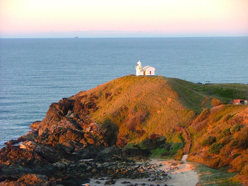 Free Lighthouse on the hill above ocean