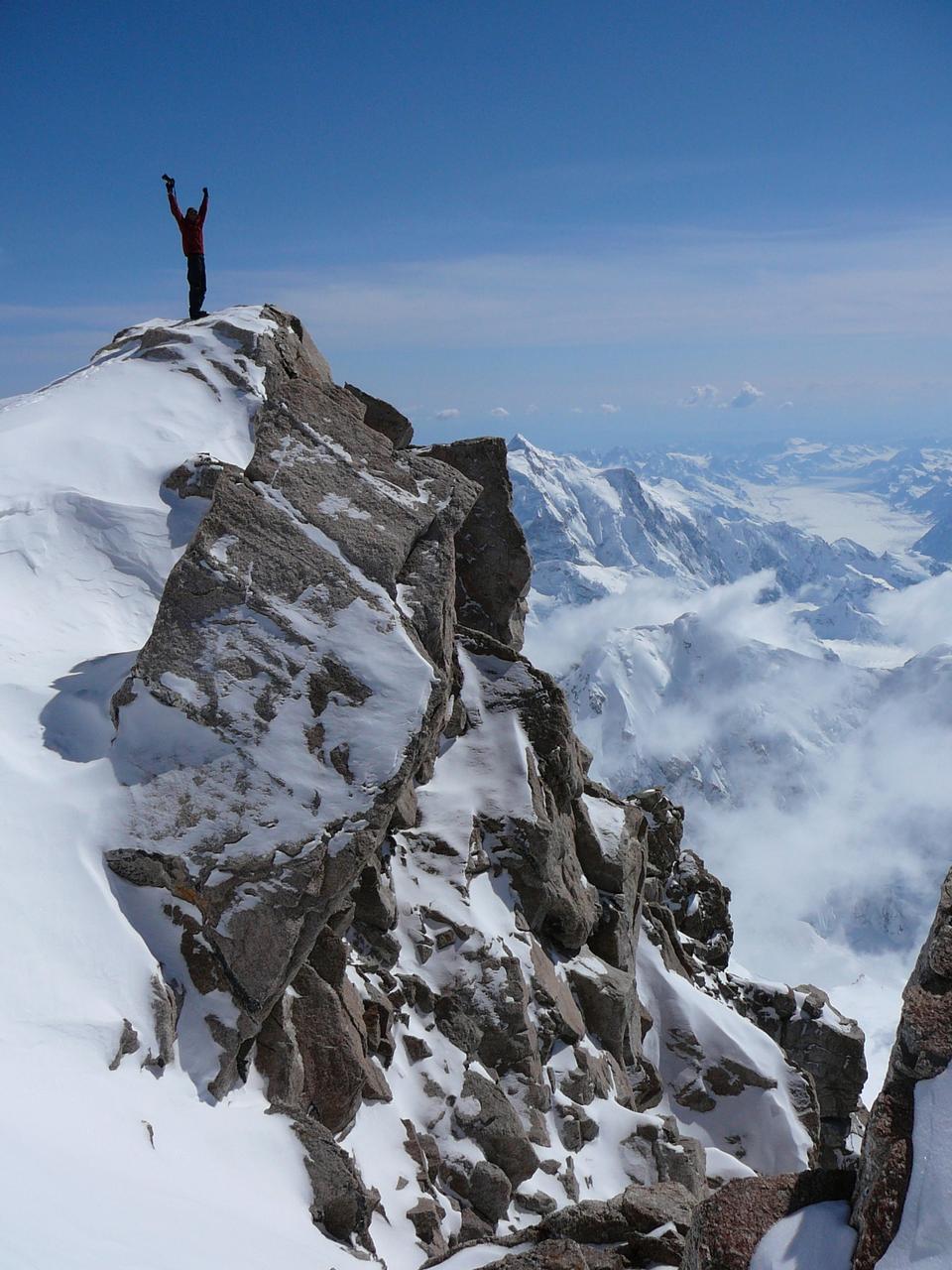 Free Man on top of mountain