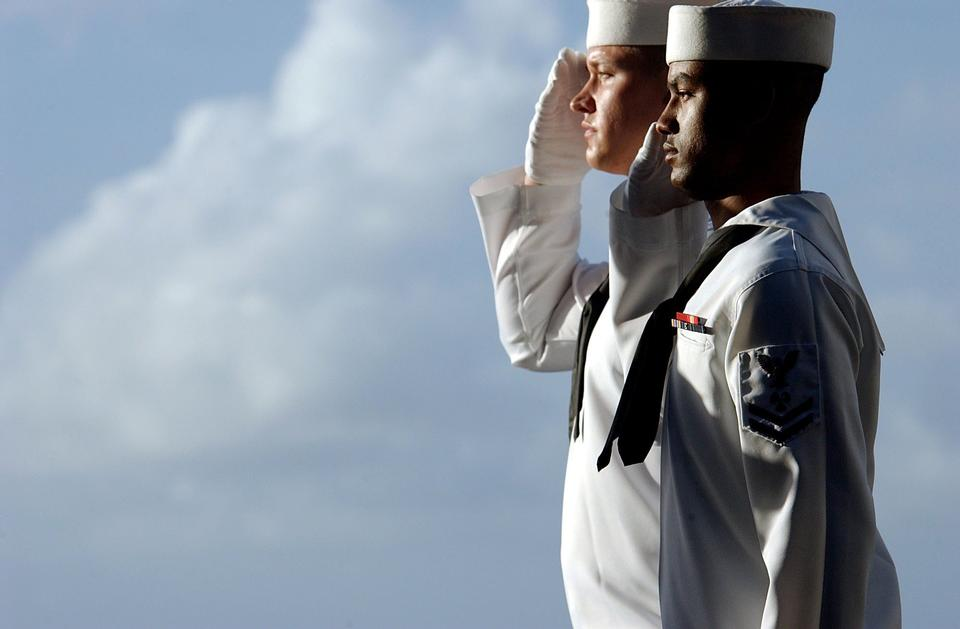 Free Ethnically diverse trio of sailors saluting