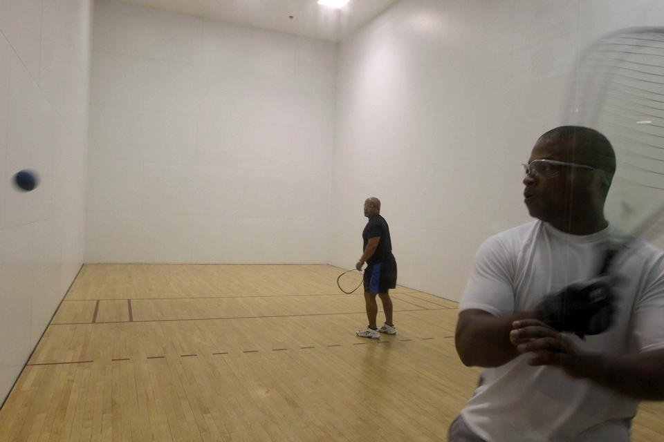 Free Male players playing a match of squash