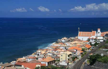 Free View of traditional village houses and port on east coast of Made