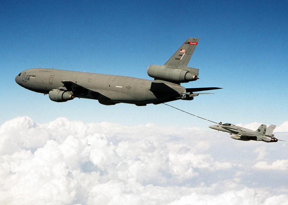 Free A United States Air Force KC-10 Extender refuels a F/A-18C Hornet