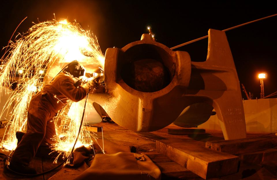 Free Sparks fly as a welder removes a cracked crown pin