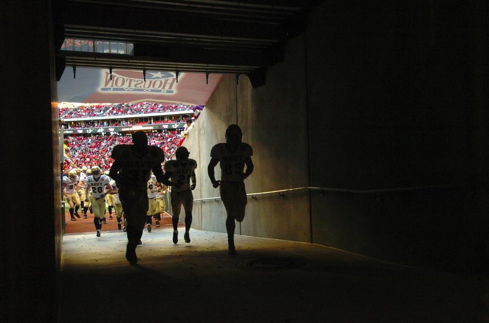 Free Football Player running out of the Stadium Tunnel