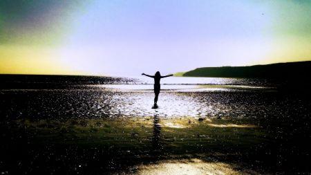 Free woman on the beach.