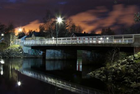 Free bridge over river at sunset with river reflections in Finland