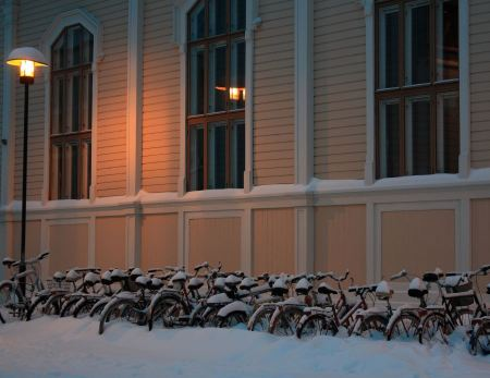 Free Snowy bicycles in front of library