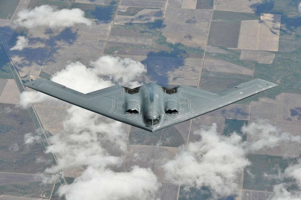 Free A B-2 Spirit bomber maintains a steady descent and departure