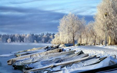 Free Boats covered with snow in Finland