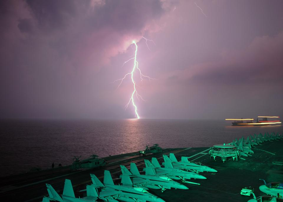 Free Thunderstorm and lightnings in night over a lake