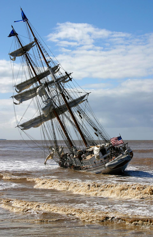 Free The tall ship Irving Johnson lies hard aground