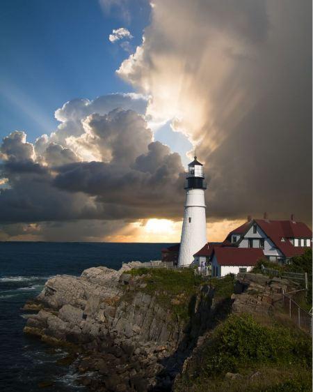 Free Seascape at sunset. Lighthouse on the coast