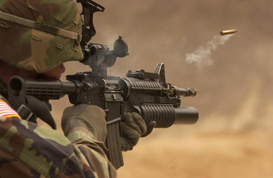 Free A shell casing flies out with a trail of smoke as U.S. Army