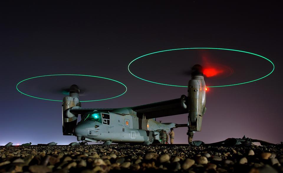 Free Crew members refuel an A V-22 Osprey vertical-lift aircraft