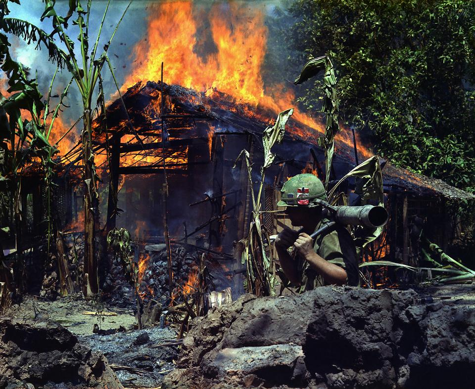 Free My Tho, Vietnam. A Viet Cong base camp being burned down