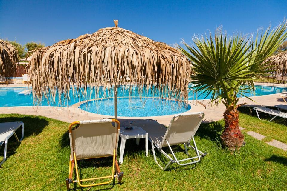 Free swimming pool at caribbean resort. Vacation