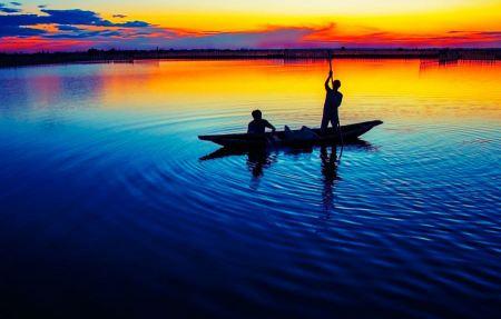 Free Fishermen at dusk