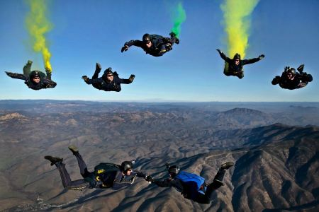 Free Skydivers parachutists jump out of an airplane