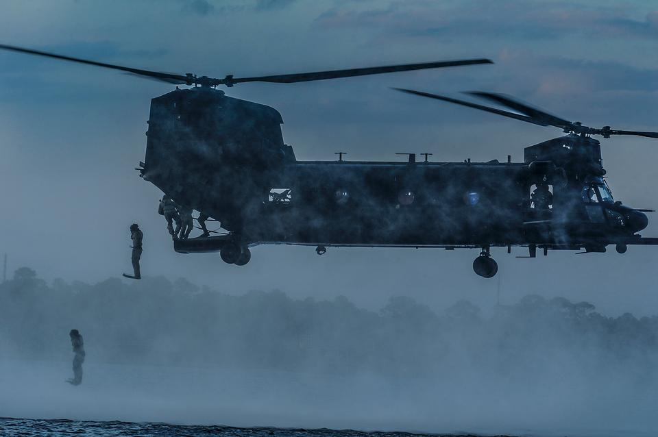 Free Airmen jump out of a MH-47 Chinook