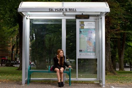 Free Young Beautiful Woman Sitting at Bus Stop