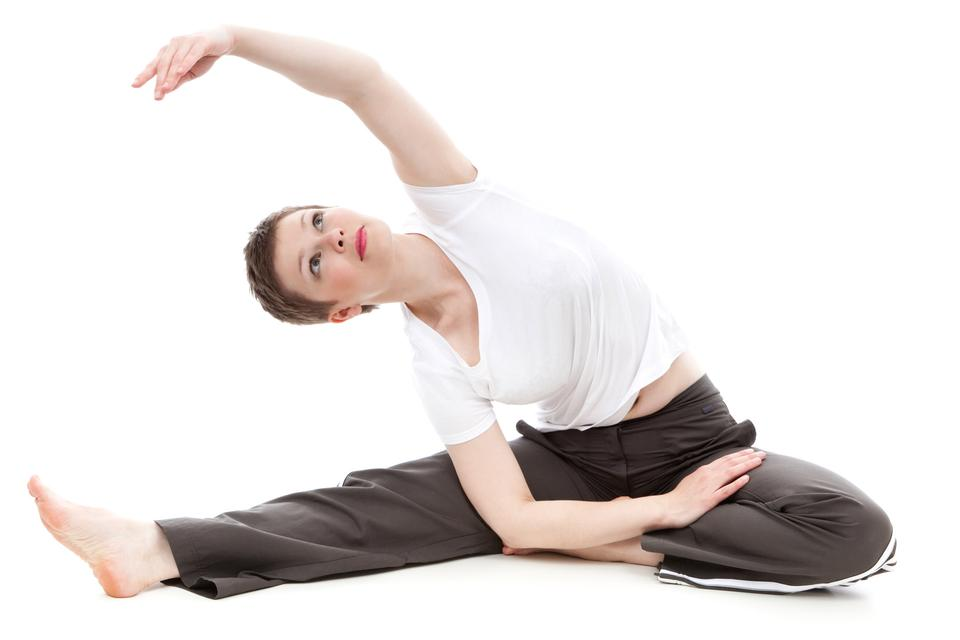 Free Flexible athletic woman stretching