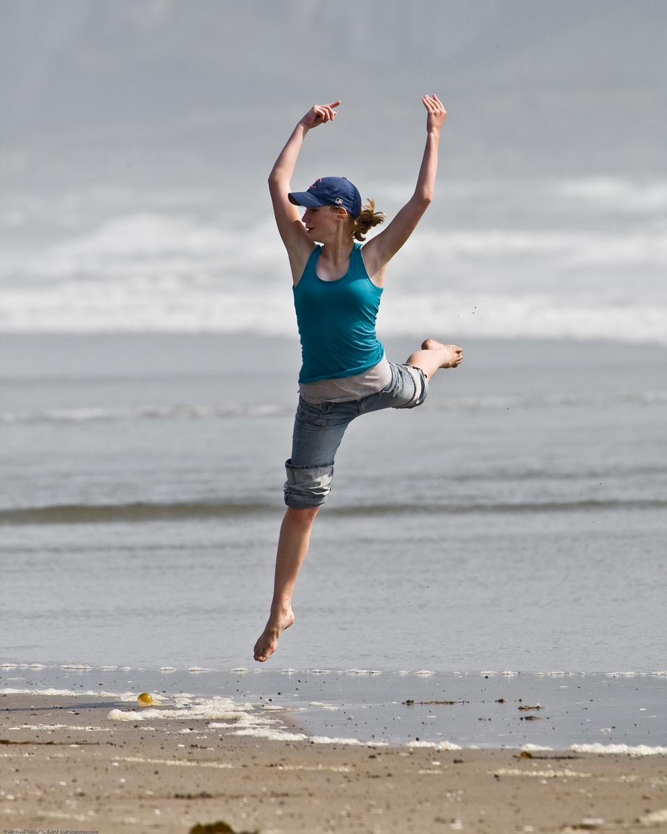 Free A Girl Jumping On The Beach
