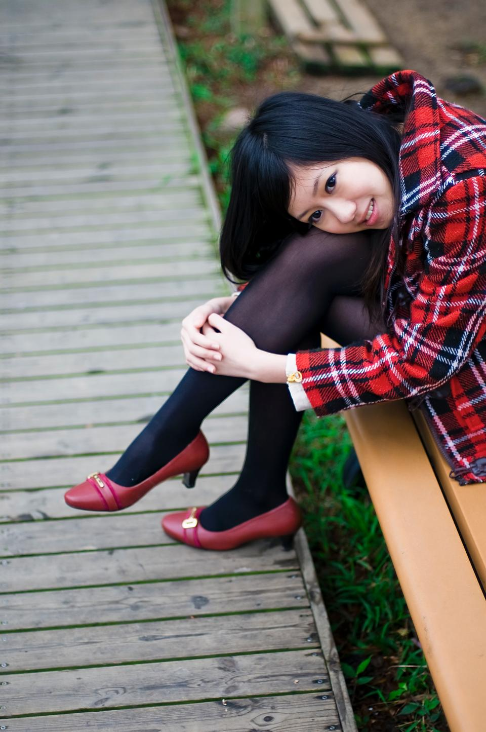 Free Japanese Girl Posing On A Bench