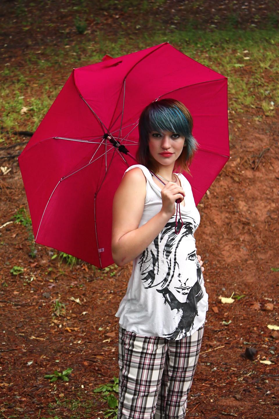 Free A Beautiful Young Woman Posing With An Umbrella