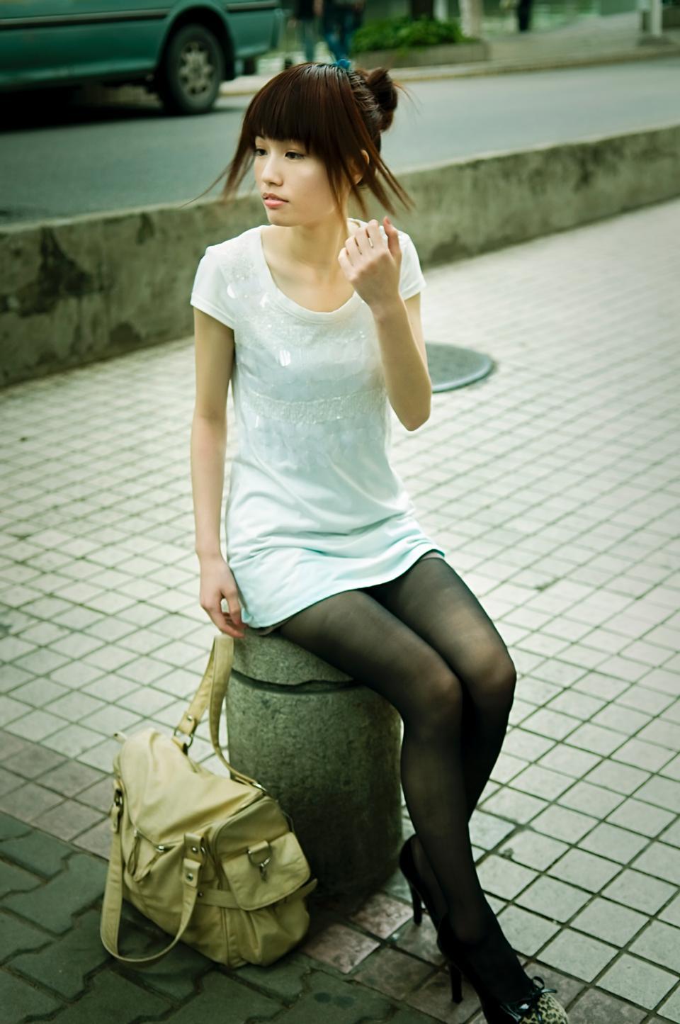 Free A Beautiful Asian Lady Posing Outdoors
