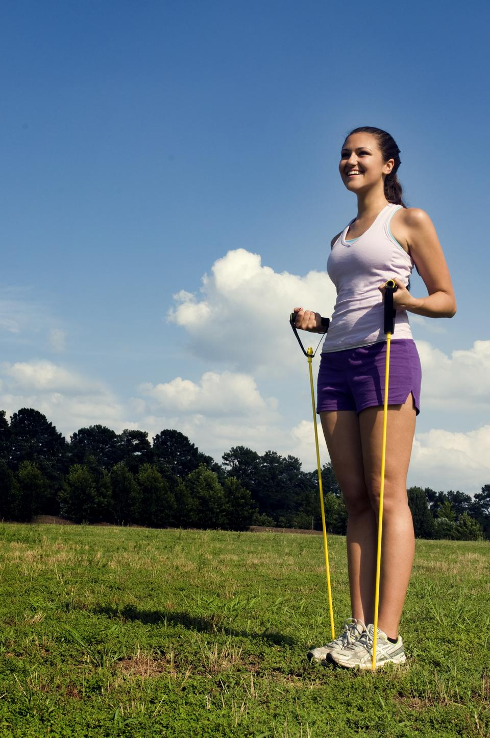 Free Young Woman Stretching Outdoors Before Exercising