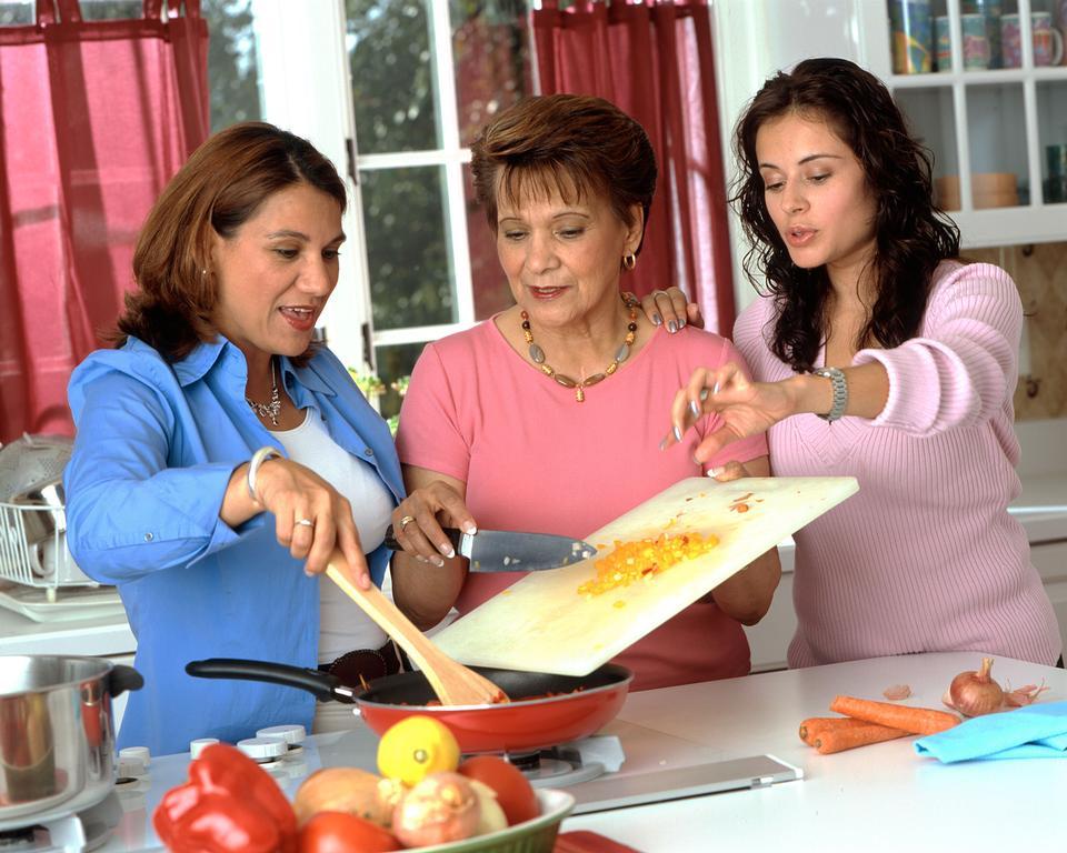 Free Hispanic Women Preparing Food