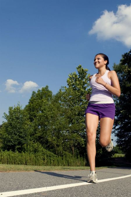 Free A Young Woman Jogging Outdoors