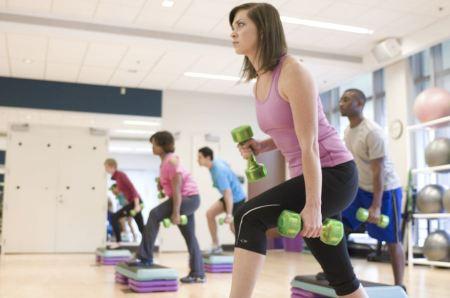 Free Men And Women Performing Aerobic Exercises