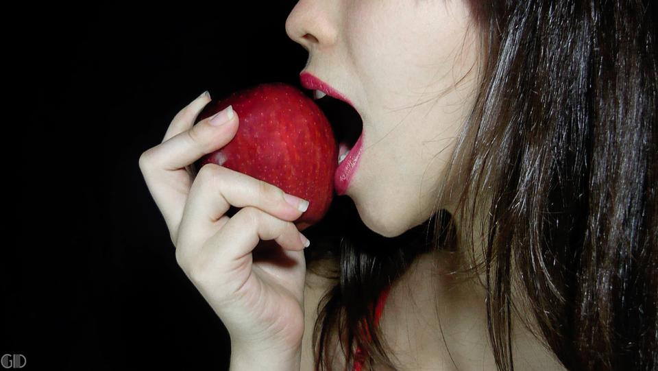 Free Beautiful Woman Eating An Apple