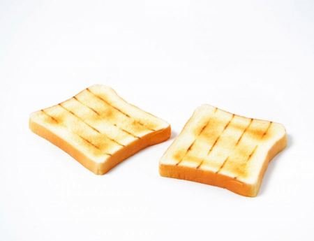 Free slices of bread on a white background