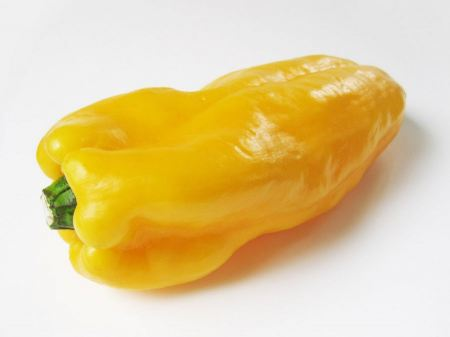 Free ripe yellow pepper isolated on white background