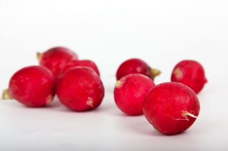 Free Red radishes on a white background