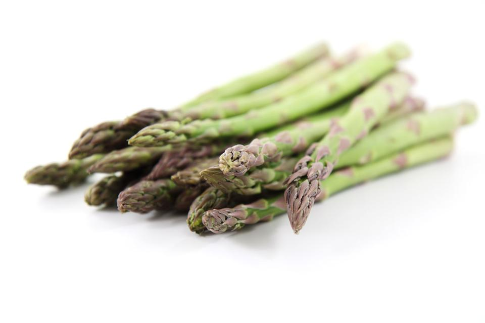 Free Green asparagus on white background