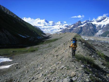 Free Backpacker crossing glacial moraine