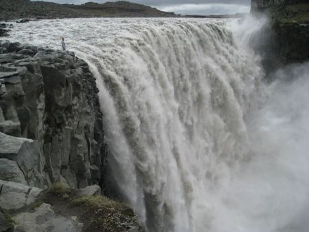 Free Panoramic view of man standing near famous Dettifoss