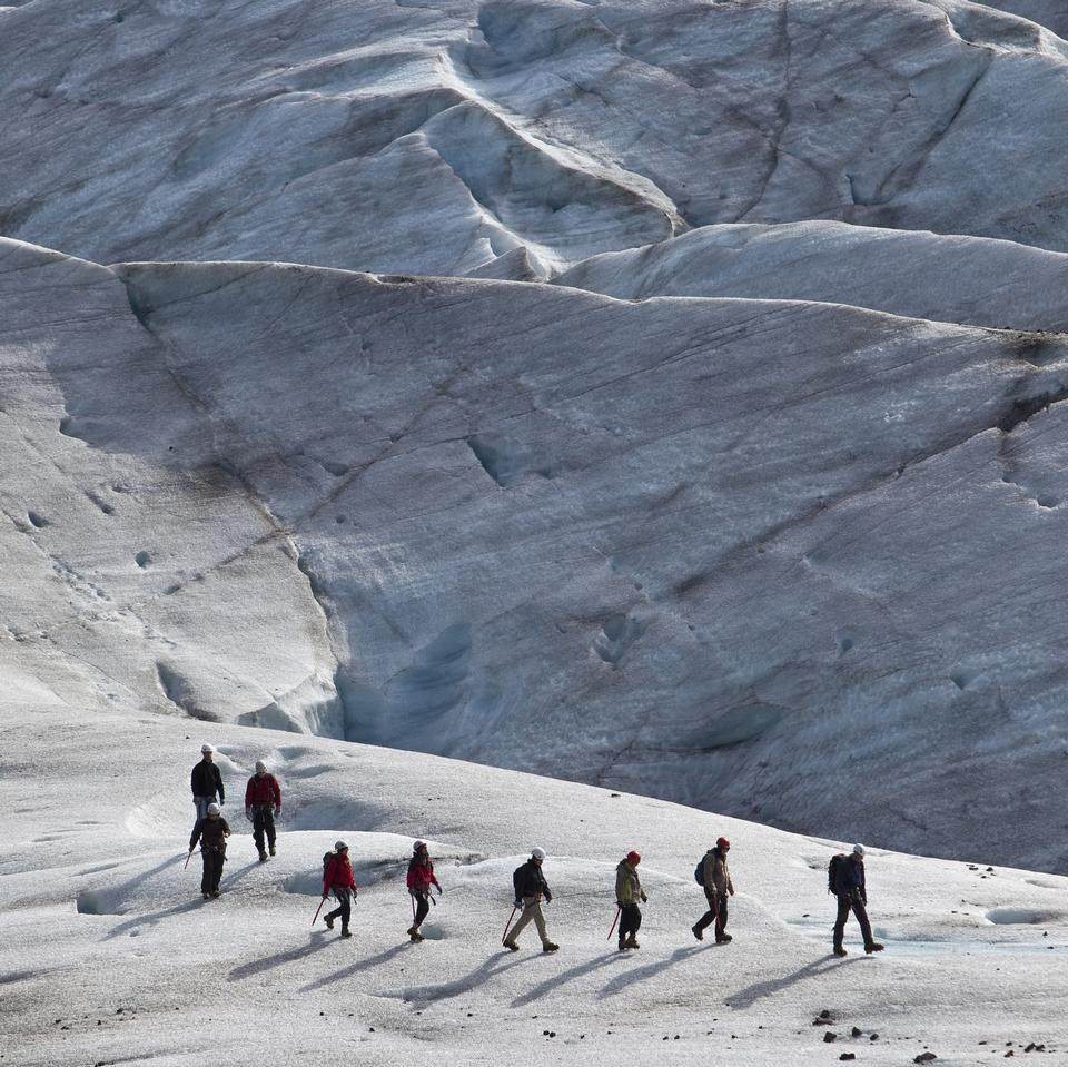 Free Group of people trekking on top of glacier