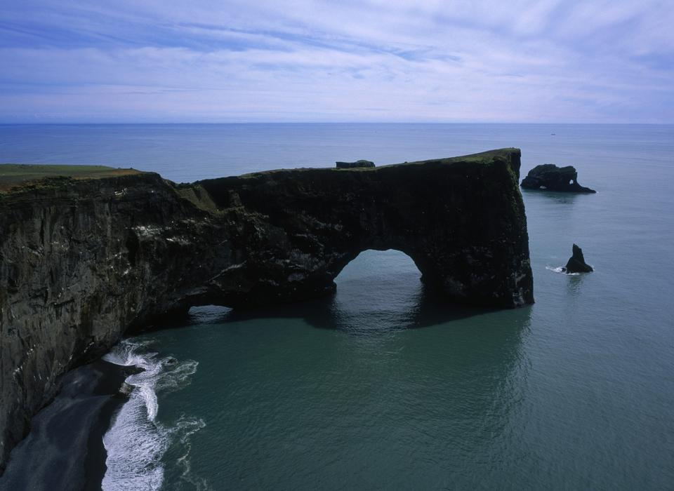 Free Dyrholaey a famous rock with a hole in it in Iceland