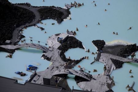 Free People bathing in the Blue Lagoon geothermal bath resort